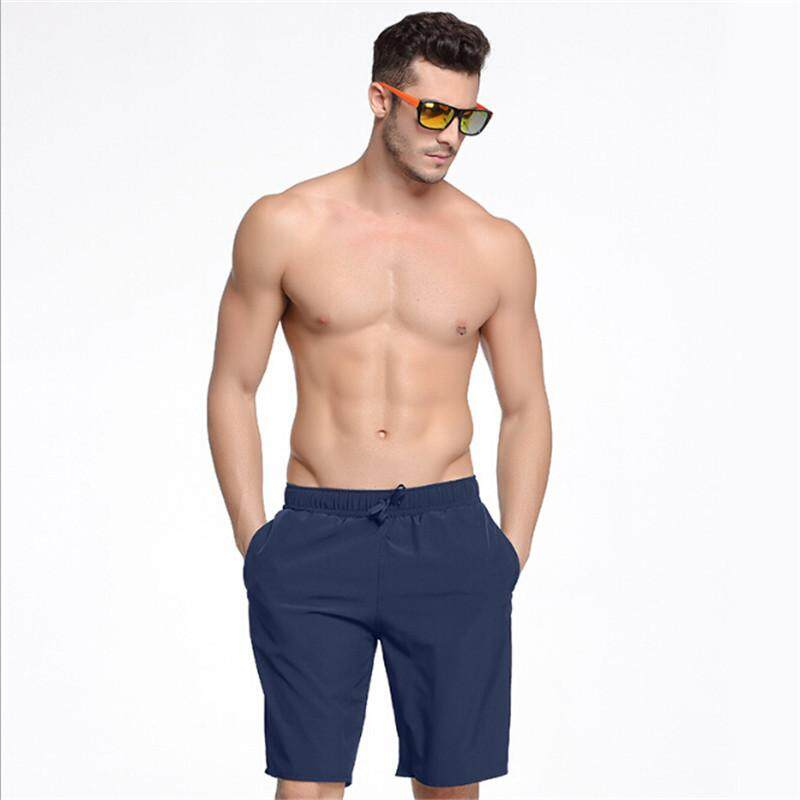 22d0fc936c2bc Luoke 2019 New Quick Dry Mens Beach Sports Shorts Summer Man Solid Swim  Surf Board Shorts