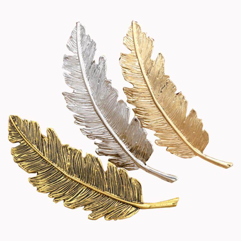 Lovely retro leaf shaped hair card, silver, gold, Old gold.