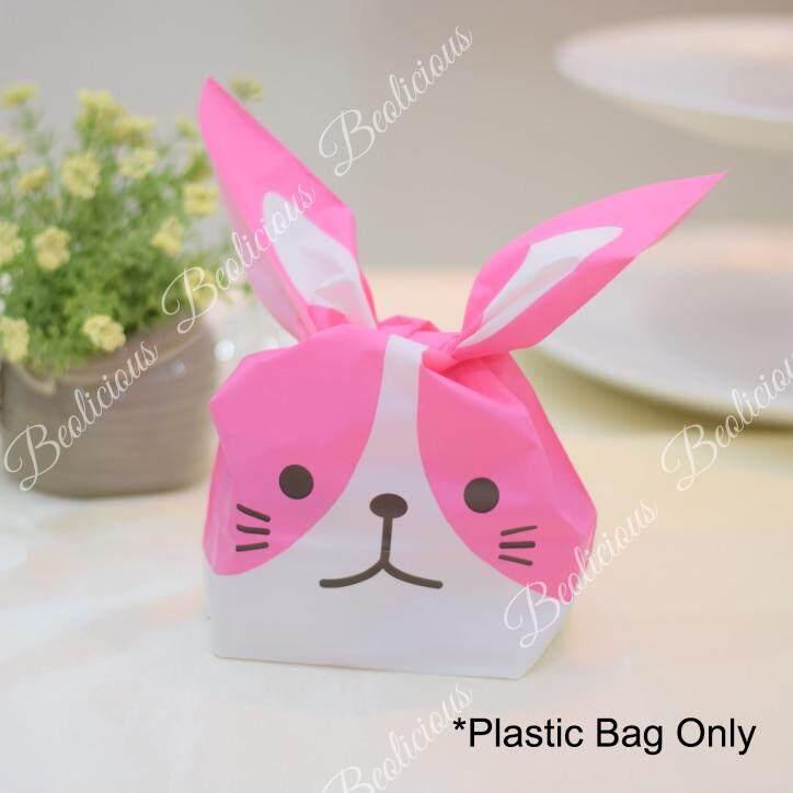 Home gift wrapping bags buy home gift wrapping bags at best 50pcs medium cute rabbit face goodies bag plastic bag gift wrapper or negle