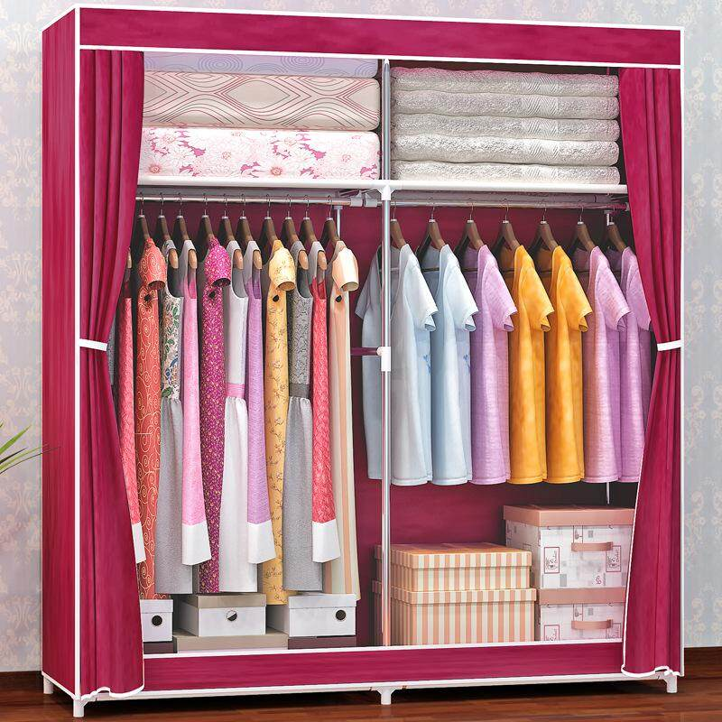 Fo A Simple Cloth Cabinet With Double Pipes Reinforced With Large Nonwoven Wardrobe Door Curtain Zipper Wardrobe.